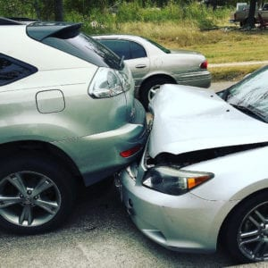 Rear-end accident involving two silver cars